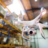 white-drone-flying-inside-the-warehouse-PQG2V8R.jpg